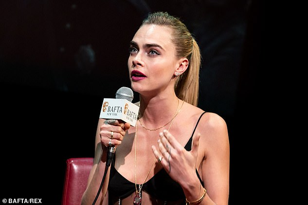Cara Delevingne sets pulses racing as she shows off her taut abs in a sheer cut-out