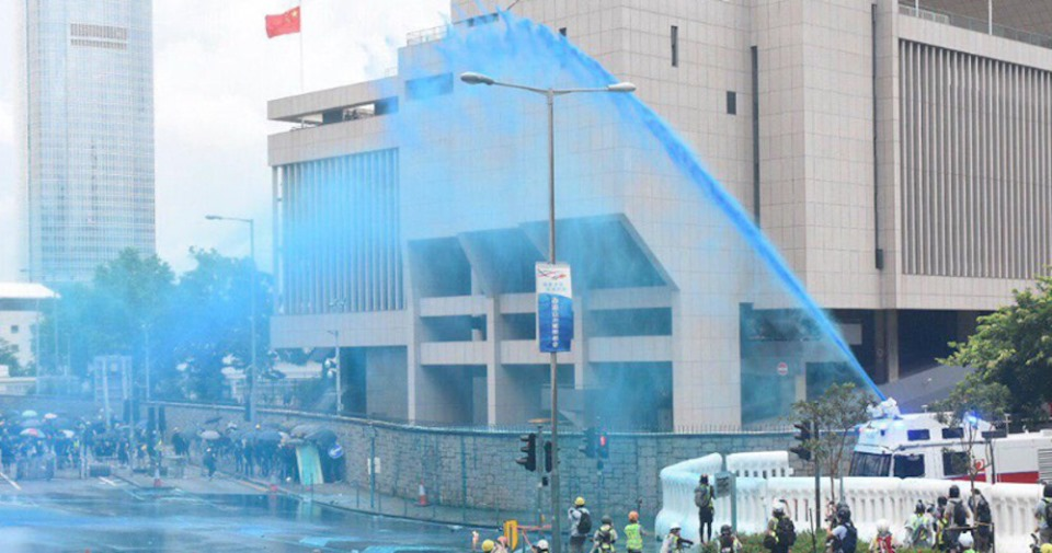 Hong Kong police fire blue-dyed water cannons at protesters
