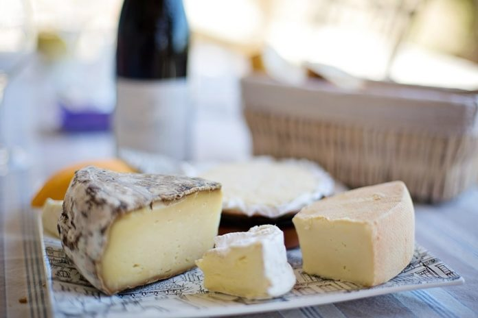 Eating cheese may control damaging blood vessels from salt- how?