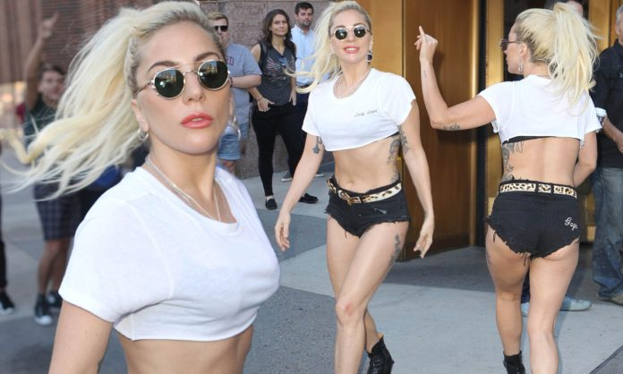 Lady Gaga flaunts a tummy! Try not to cover and you see this