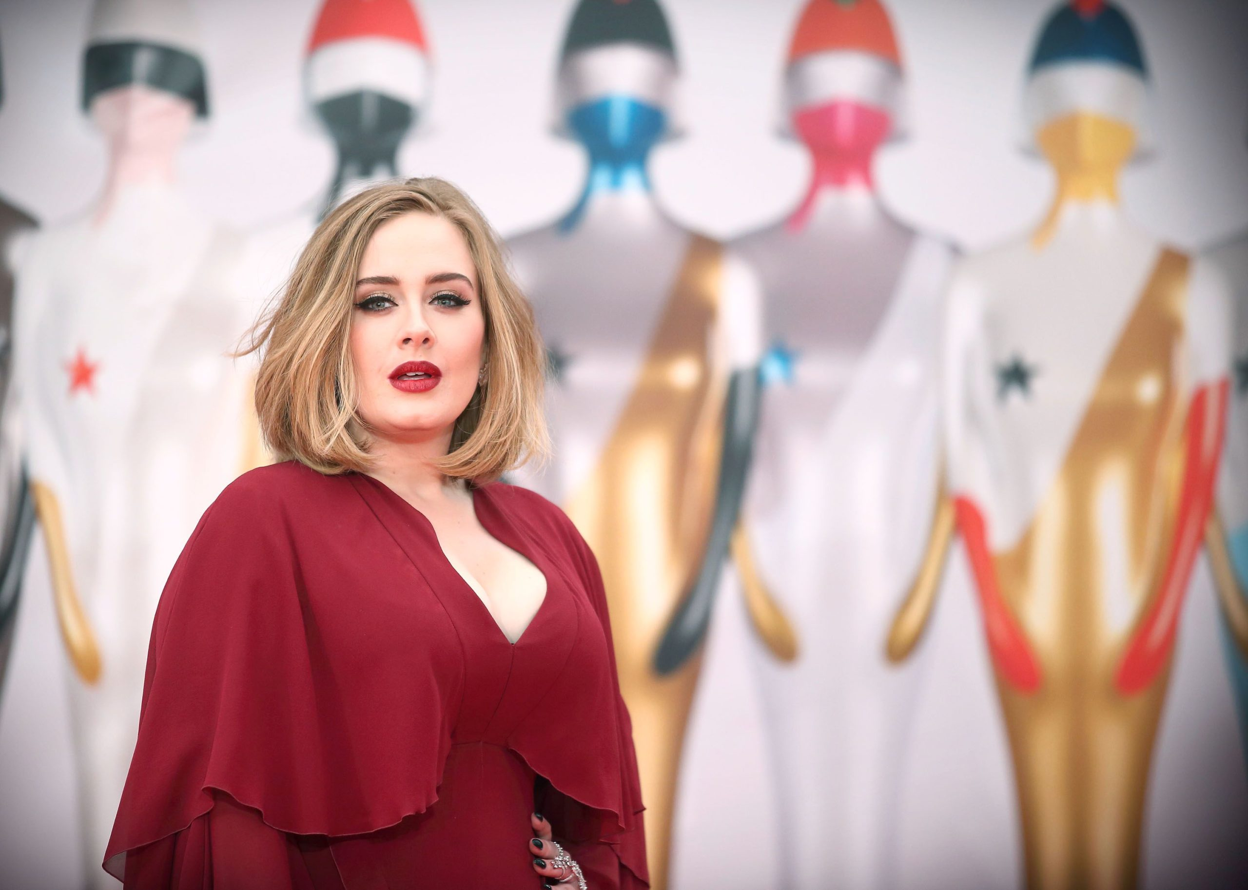 Adele Cuddles Up To Grinch whiile First Holiday Party As Single Lady