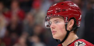 Canadian Barrett Hayton apologized for keeping his helmet on during the Russian national Anthem