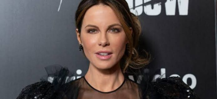 Kate Beckinsale effectively changes minds in dark hued outfit with a diving neck area