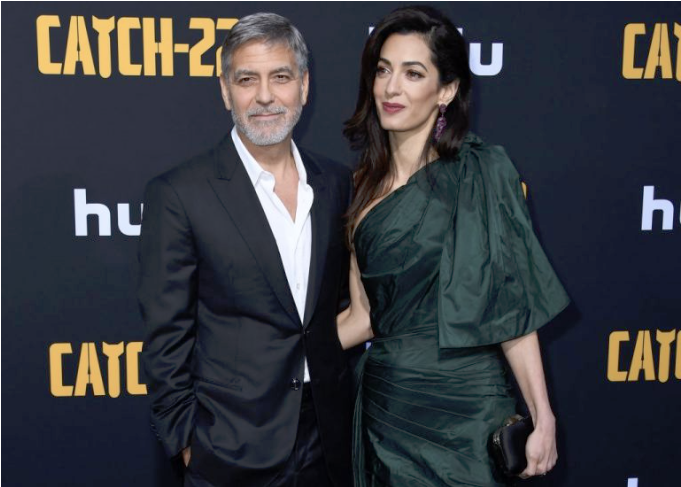 George and amal at an event